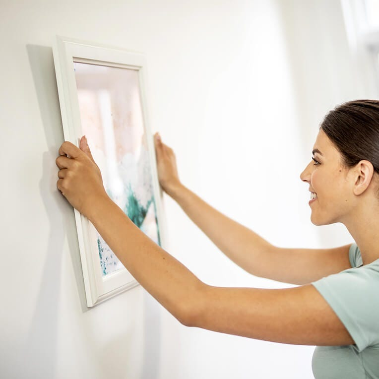 hang pictures without damaging walls